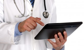 bigstock-doctor-using-a-digital-tablet-31270601-329x196