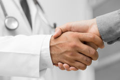 doctor-shakes-hands-patient-hospital-64054443